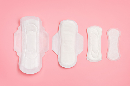 Set of different sanitary napkins on pink background. Concept of critical days, menstruation 写真素材 - 123828035