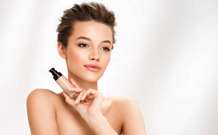 Woman with liquid foundation. Photo of woman with perfect makeup on white background. Beauty concept