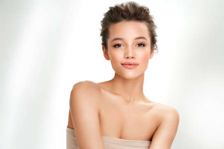 Beautiful woman with perfect makeup on white background. Beauty and skin care concept 免版税图像
