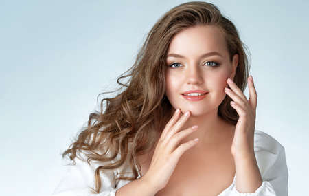 Beautiful woman with perfect makeup on white background. Beauty and Skin care concept. Plus size model.