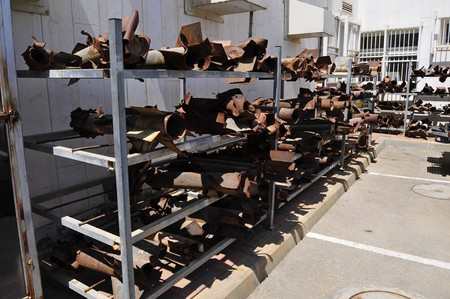 palestinian: July 16, 2014, Sderot, Israel. Empty Kassam rockets and motor shells fired at Israel by Palestinian militants piled at the police station during Defense Shield operation in Gaza Strip. Stock photo.