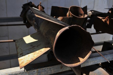 zealous: July 16, 2014, Sderot, Israel. Empty Kassam rockets and motor shells fired at Israel by Palestinian militants piled at the police station during Defense Shield operation in Gaza Strip. Stock photo.