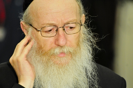 knesset: JERUSALEM, ISRAEL - June 10, 2014. Deputy Minister of health in the Israeli government Yakov Litzman giving comments to journalists during the presidential elections in the Israeli Parliament Knesset.