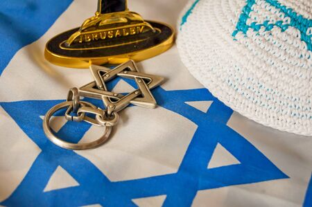 zionism: Jewish symbols: customary religious kippah cap, a Star of David and a foundation of a menorah (a seven-lamp candelabrum) with the word Jerusalem written on it. Zionism symbol.