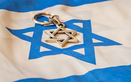 zionism: Star of David, Jewish religion symbol on Israel flag stock image. Jewish identity, Bar mitzvah, Israel Independence Day, Zionism vs. Judaism. Jewish hexagram.