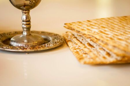 matzah: Silver wine cup with matzah, Jewish symbols for the Passover (Pesach) holiday. Passover concept.