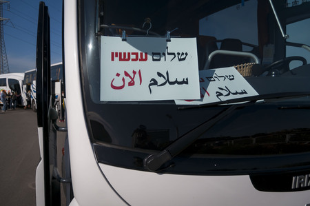 Peace Now (Shalom Achshav in Hebrew) buses lined up for a tour for the Israeli public in the West bank. Peace Now is a leftist watchdog organization. Umm el-Fahm, Israel, January 2014.
