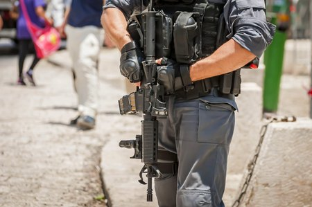 JERUSALEM, ISRAEL. June 20, 2017. Armed with an M-16 Israel border police officer on guard at the terror attack site by the Damascus gate of the Old city of Jerusalem. Security measures stock image.