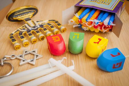 The Jewish Hanukkah holiday concept stock image. Hebrew letters on dreidel teetotum say Nes Gadol Haya Poh (A great miracle happened here).