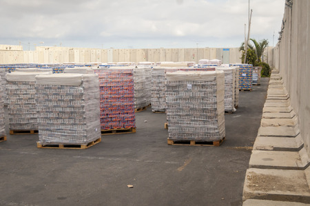 Goods supply - food and construction materials piled up at the Kerem Shalom border crossing to the Gaza strip before security check. Kerem Shalom terminal, Israel, Circa September 2013. Gaza blockade Editorial