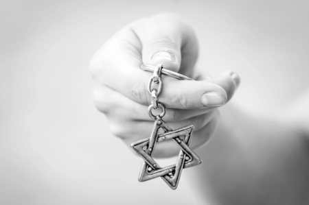 Young womans hand holding a Star of David,