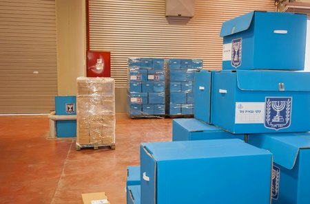 SHOHAM, ISRAEL. February 24, 2015. Blue ballot boxes for the IDF soldiers inside the Central Elections Committee main office prior to the parliamentary elections to the twentieth Knesset. The Israeli Central Elections Committee concept image.