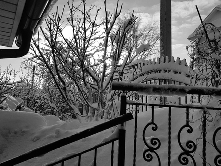 Railing and handrail stairs on the background of snow in winter