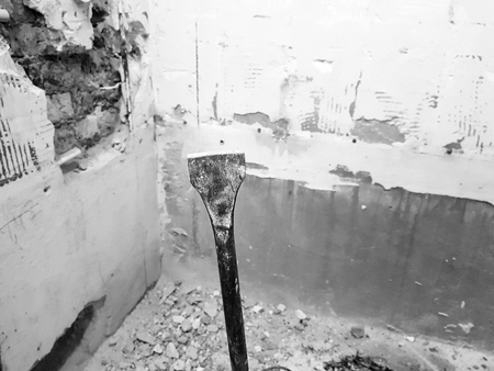 a drill from a perforator, a chisel and a strobe in a brick wall and a propylene pipe - plumbing in the bathroom