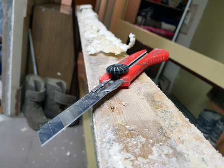 Repair - a sharp building knife on the door jamb with mounting foam
