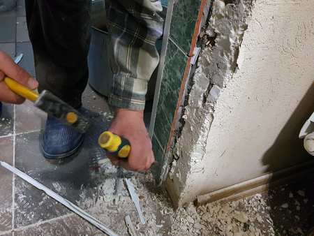 Repair - tool chisel in the hands of the builder or finisher