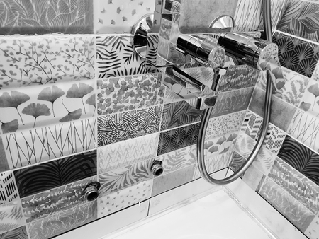 Repair and plumbing - water tap on a tile in the bathroom Archivio Fotografico
