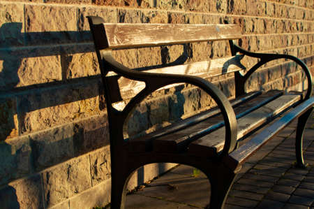 A lonely bench for relaxing on a bright autumn day in the Park