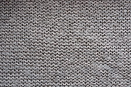 Hand-made pattern. Knitted texture. Selective focus background.