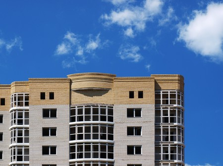 New multi-storey building construction on a background of blue sky photo