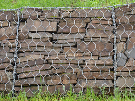 landslip: Small stone walls for protection against landslip Stock Photo