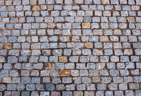 rough road: Old road pavement of the small rough granite tiles