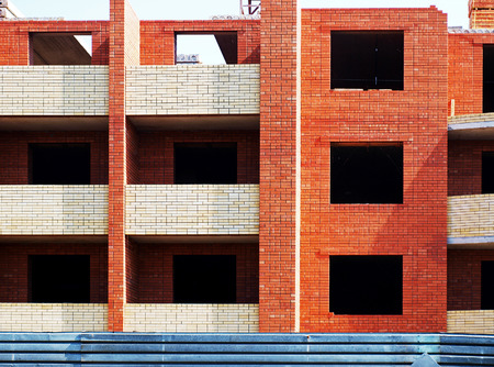 multistory: Multistory building from brick under construction closeup