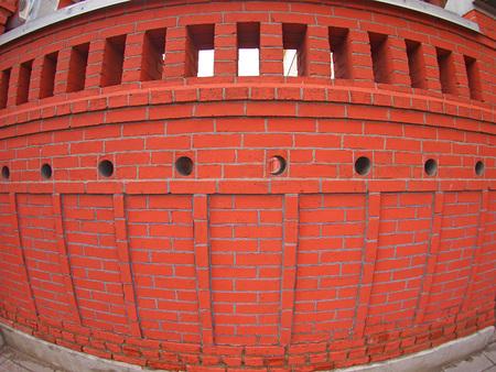 fisheye: Red brick wall  with wide angle fisheye view Stock Photo