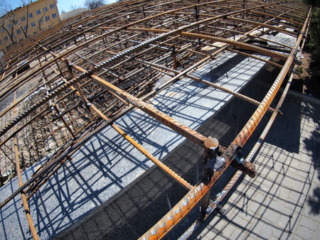 reinforcement: Urban construction site with metal reinforcement, focus on foreground with wide angle fisheye view Stock Photo