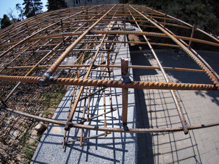 round rods: Urban construction site with metal reinforcement, focus on foreground with wide angle fisheye view Stock Photo