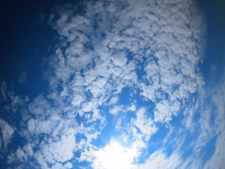 ''wide angle'': Only the sky with bright clouds with wide angle view Stock Photo