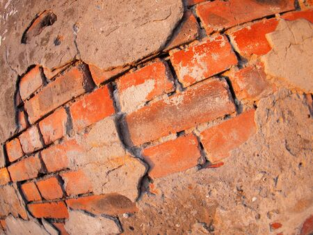 Fragment of an old shabby brick wall with wide angle fisheye lens view photo