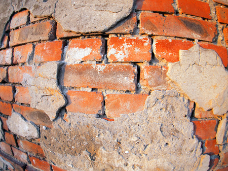 parget: Fragment of an old peeling brick wall with wide angle fisheye lens view