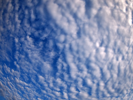 stratus: Dense and stratus clouds against the blue sky with wide angle fisheye lens and distortion view Stock Photo