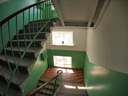 The interior staircase between floors in highrise building with wide angle fisheye lens and distortion view