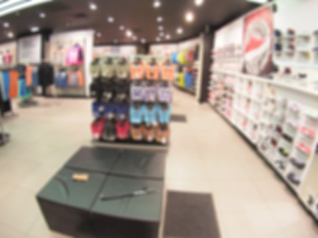 Defocused and blurry image of the interior of the shoe store with wide angle distortion view was blurred for use as a background Stock Photo