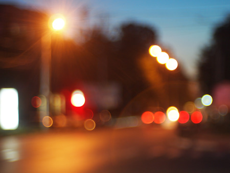 street lights: Night scene on the road - blurred lights of cars in the form of circular highlights formed in abstract image Stock Photo
