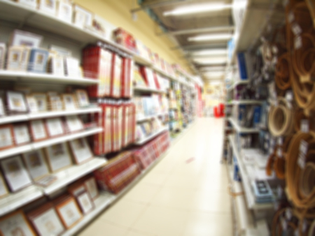 book racks: Blurred and defocused view of the shelf in the store with a variety of products with wide angle fisheye lens and distortion view for use as a background