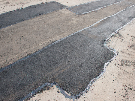 patching: Repair pavement and laying new asphalt patching method outdoors