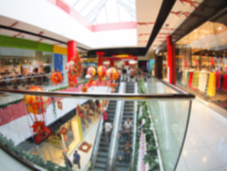 view of a staircase in a shop: Blur overhead view on the escalator in a shopping mall with wide angle distortion view. Image was defocused for use as background