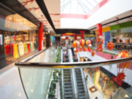view of a staircase in a shop: Blurred overhead view on the escalator in a shopping mall with wide angle distortion view. Image was defocused for use as background