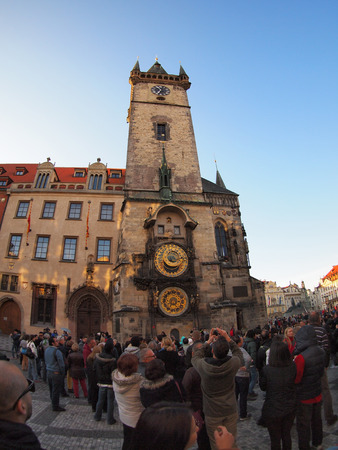 Prague, Czech Republic - April 19, 2015: The crowd of tourists photographed clock in the square Stare Mesto with wide angle distortion view