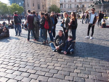 stare mesto: PRAGUE, CZECH REPUBLIC - APRIL 22, 2015: Tourists on the area of Stare Mesto watching presentation Editorial