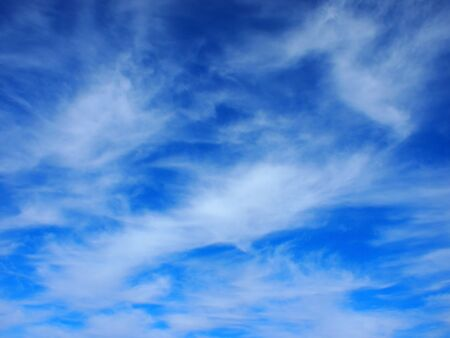 cirrus: Background of white cirrus clouds in the blue sky