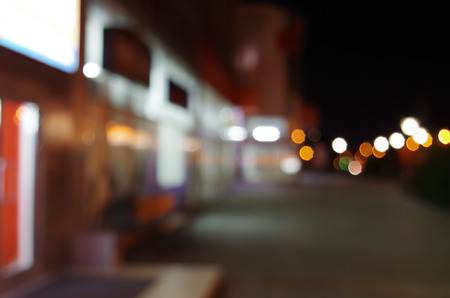 diffuse: Night urban scene with diffuse lighting shop windows and lanterns on the street for use as a background.