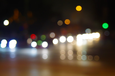 night spots: Abstract blurry spots of light in the night city street scene with reflections of neon lights and headlights Stock Photo