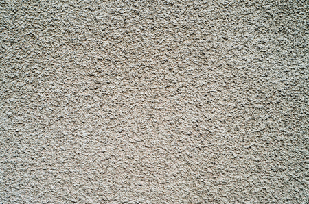 granular: Detail of gray wall closeup uneven granular cement coating for use as a background