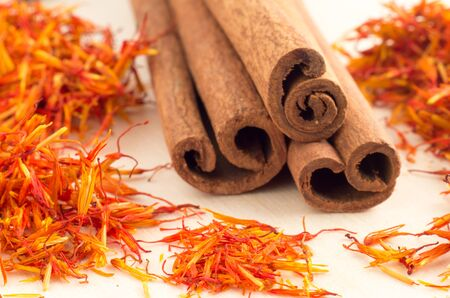 Macro view of the sticks of cinnamon and saffron close-up with shallow depth of field Stock Photo