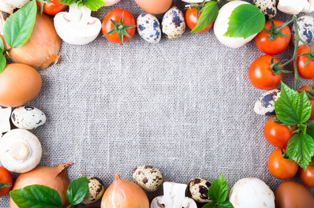 Organic products from the farm. Top view of the food ingredients in the form of a frame with an empty space in the center. Reklamní fotografie