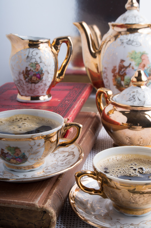 Antique porcelain coffee cups with hot espresso and tableware from the 19th century German Bavaria